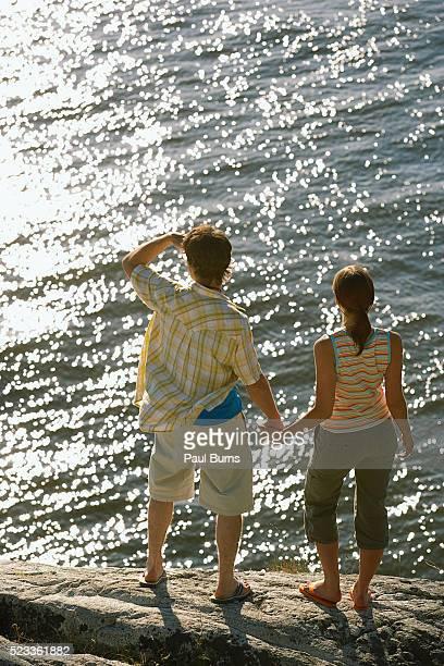 Couple beside a lake