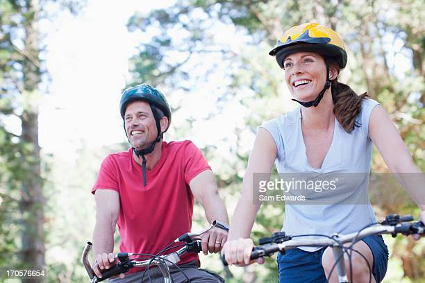 Couple bicycle riding in forest