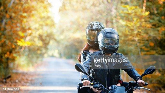 couple biker riding motorcycle : Stock Photo
