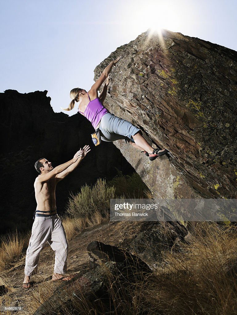 Couple bouldering, man spotting : Stock Photo