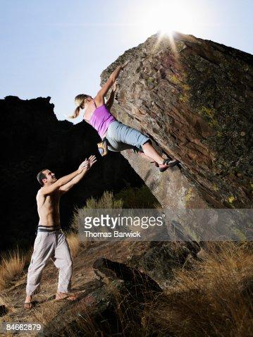 Couple bouldering, man spotting : Stock Photo