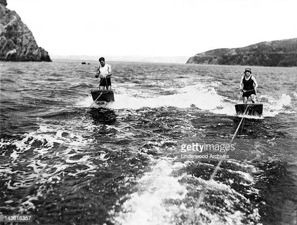 A couple brave the chilly waters of San Francisco Bay for a high speed dual aquaplane ride San Francisco California August 24 1923