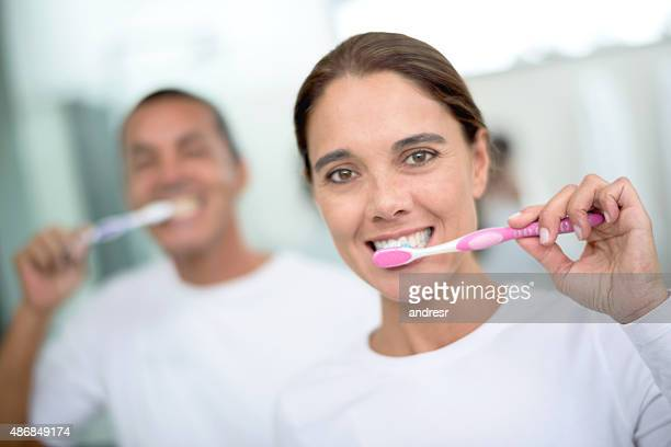 Couple brushing their teeth in the morning