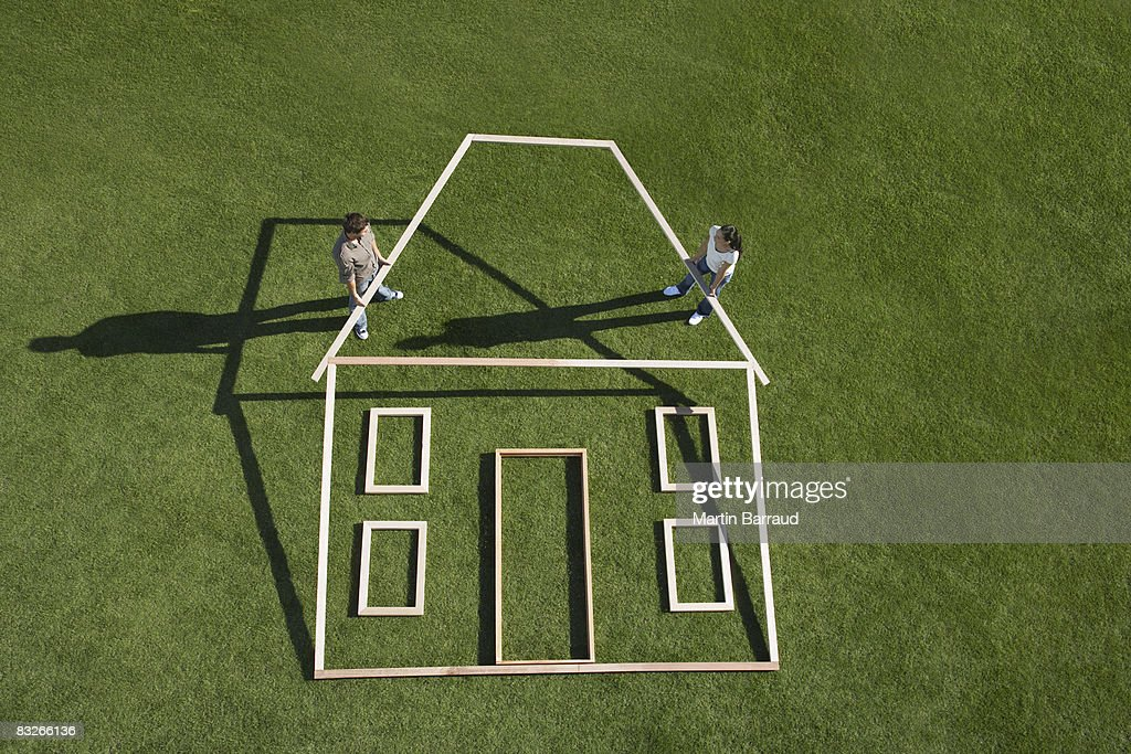 Couple building house outline : Stock Photo