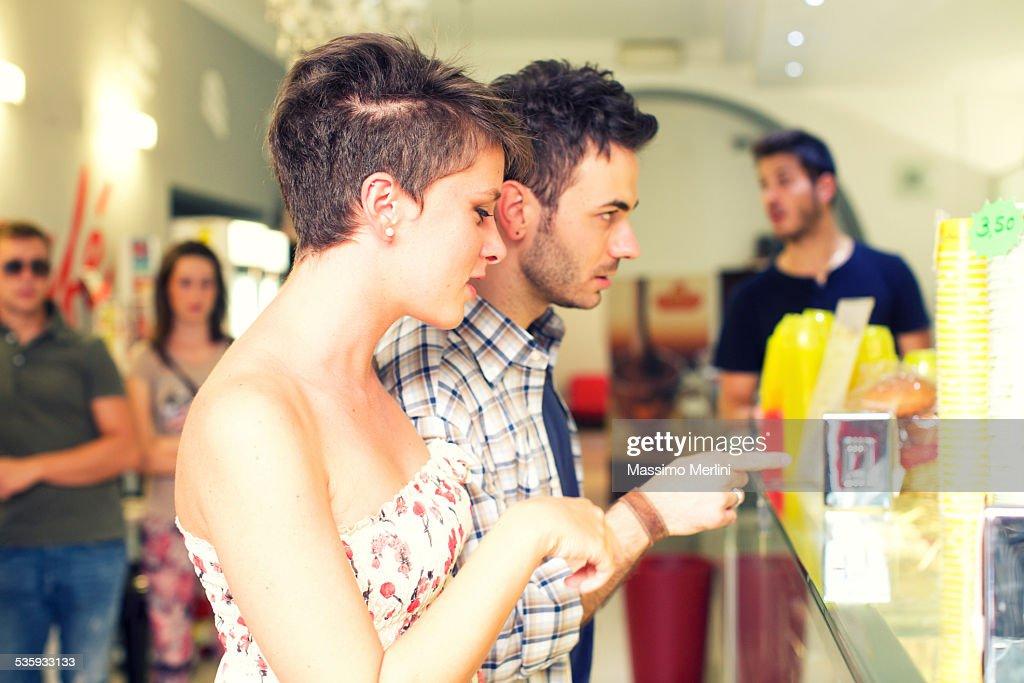 Couple buy an ice cream cone : Stock Photo