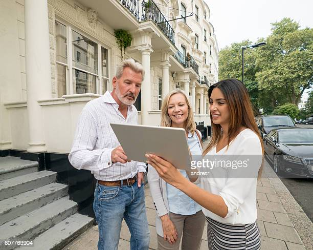 Couple buying a house - real estate concepts