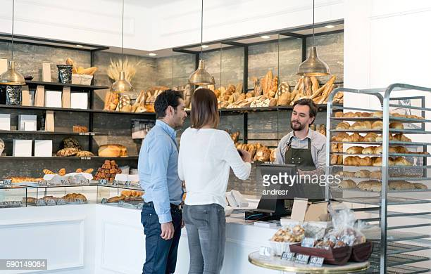 Couple buying bread at the bakery