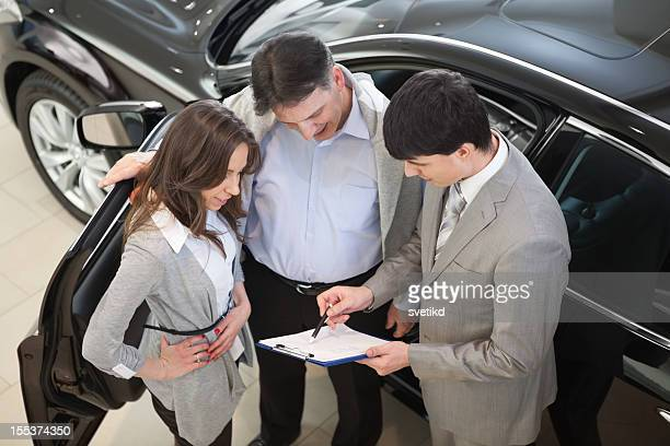 Couple buying car.