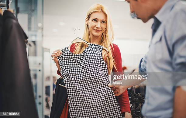 Couple buying clothes at a mall.