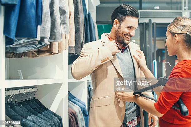 Couple buying clothes at department store.