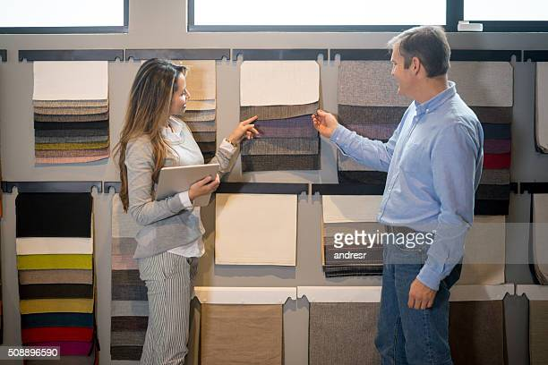Couple buying fabrics at a furniture store
