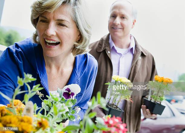 Couple Buying Flowers at Supermarket