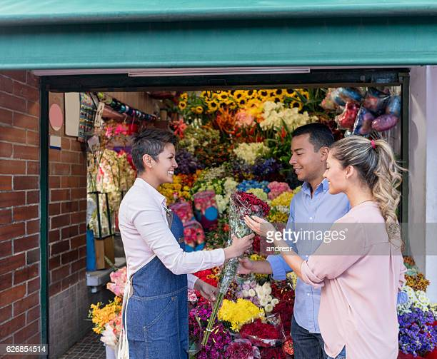 Couple buying flowers at the florists