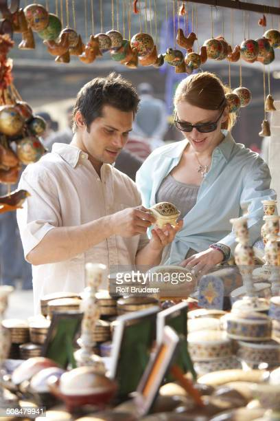 Couple buying food at outdoor market