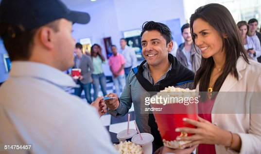 Couple buying food at the cinema