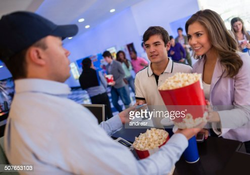 Couple buying food at the movies