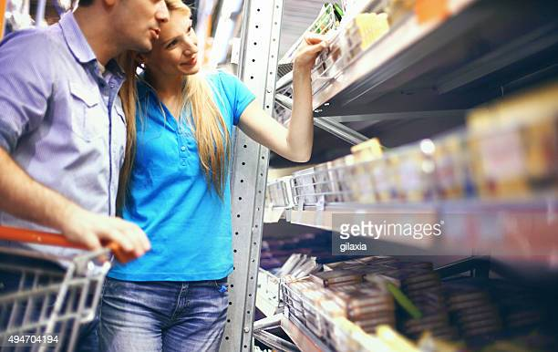 Couple buying food in supermarket.