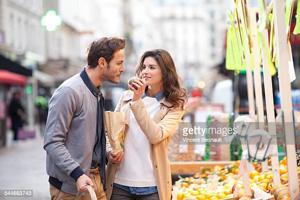 Couple buying fruit at the market