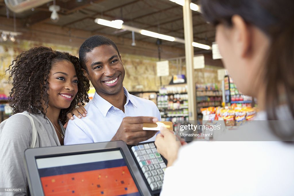 Couple buying groceries in supermarket : Stock Photo