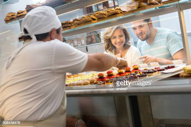 Couple buying pastries at a bakery