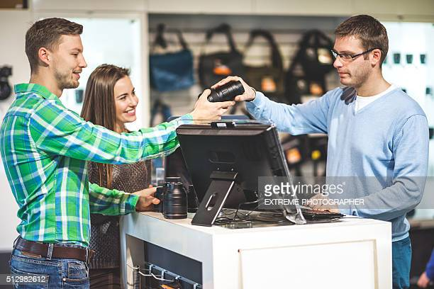 Couple buying photographic equipment