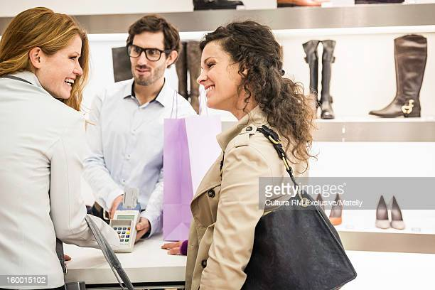 Couple buying shoes in store