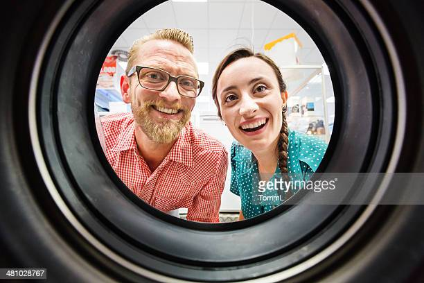 Couple Buying Washing Machine In Appliance Store