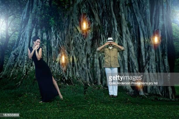 Couple by illuminated banyan tree