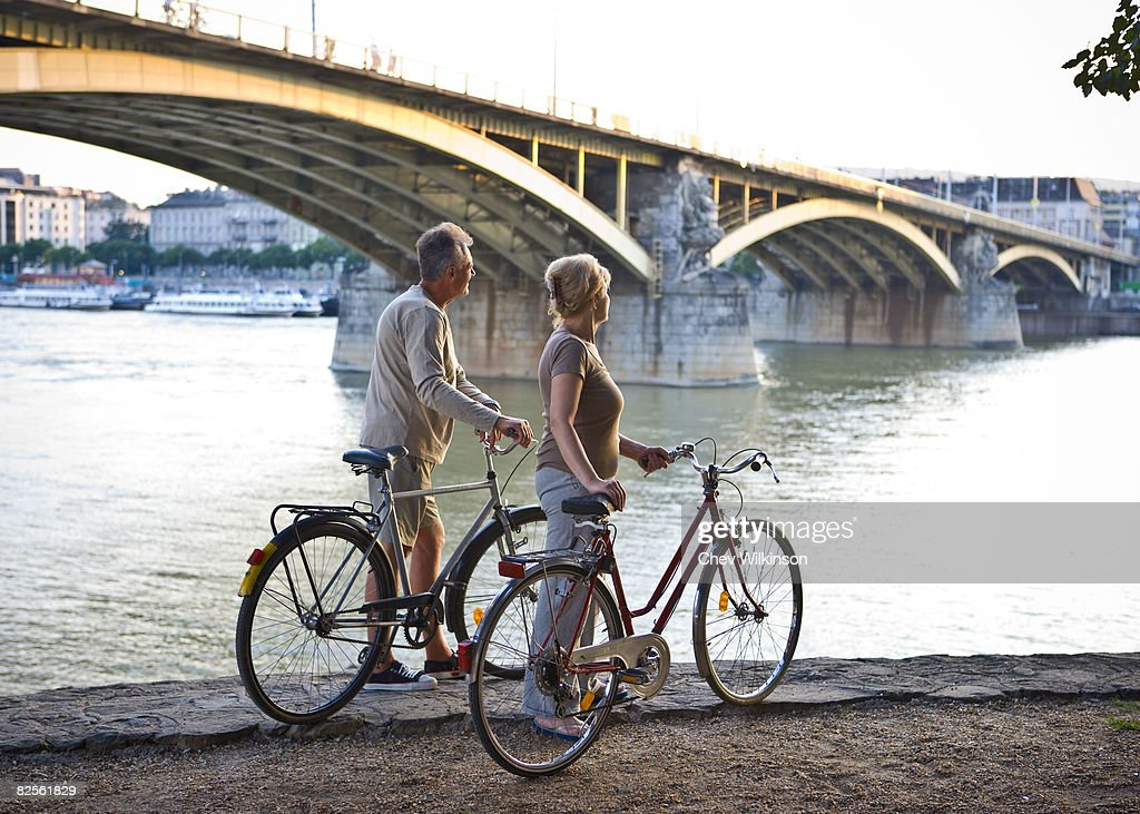 Couple by river with bikes