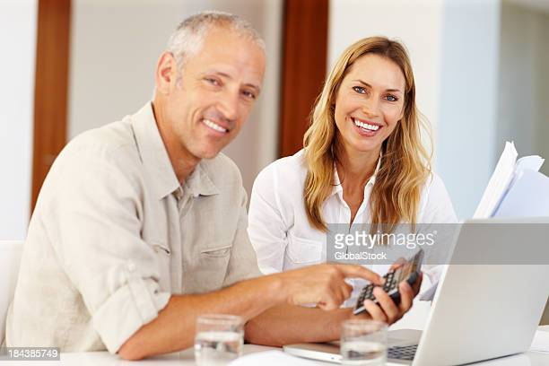 Couple calcuting home finances