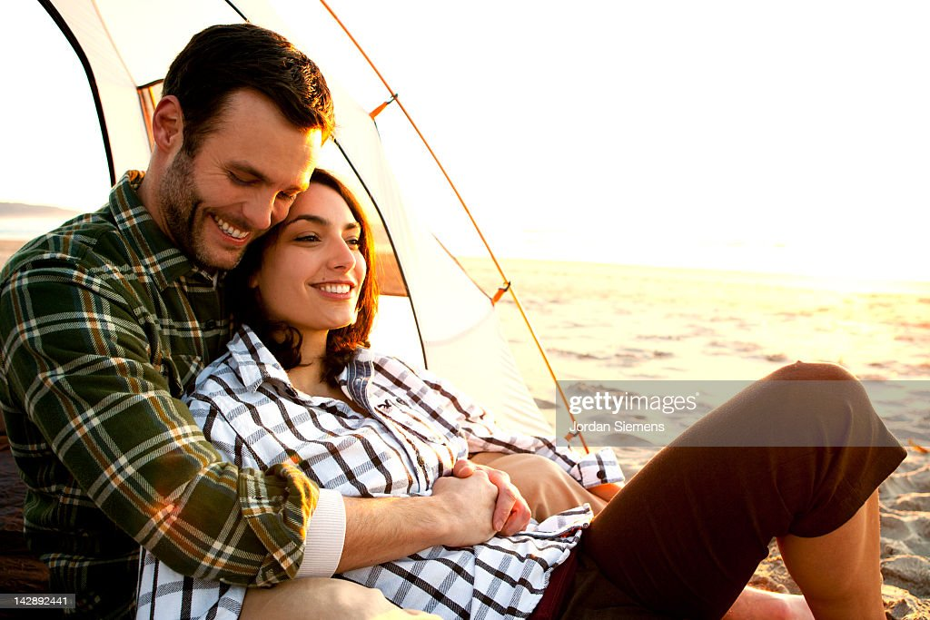 Couple camping at the ocean. : Stock Photo