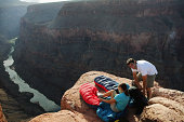 Couple camping on canyon cliff