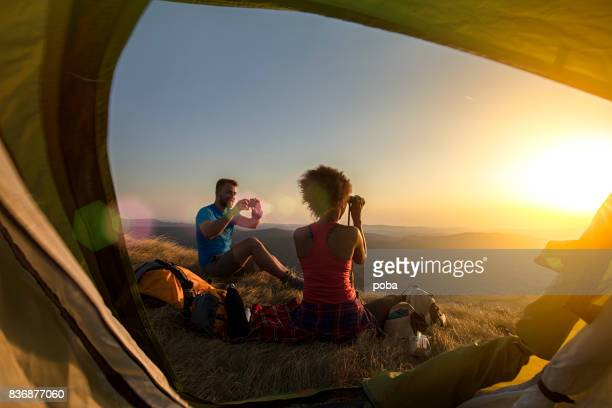 Couple camping on mountain