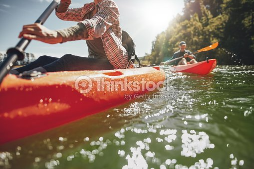 Couple canoeing in a lake on a summer day : Stock Photo