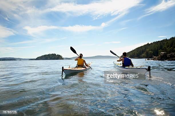 Couple Canoeing on Lake