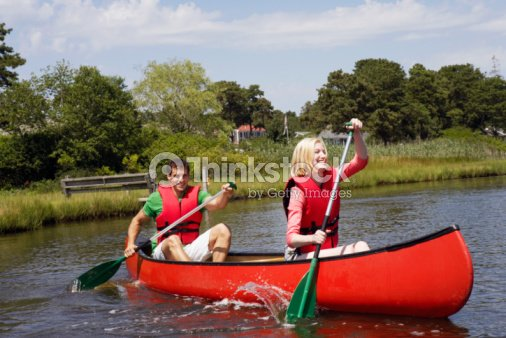couple canoeing stock foto thinkstock. Black Bedroom Furniture Sets. Home Design Ideas