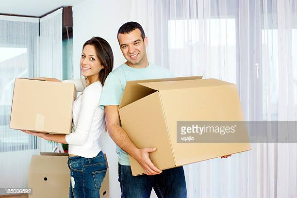 Couple Carry Boxes Moving House