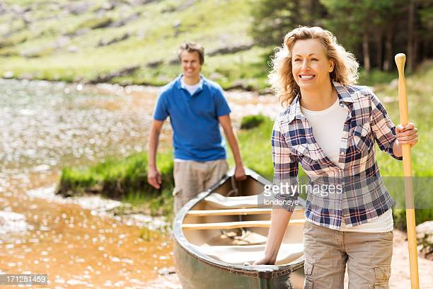 Couple Carrying a Boat