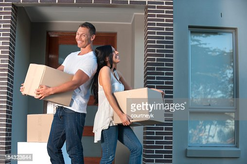 Couple carrying boxes
