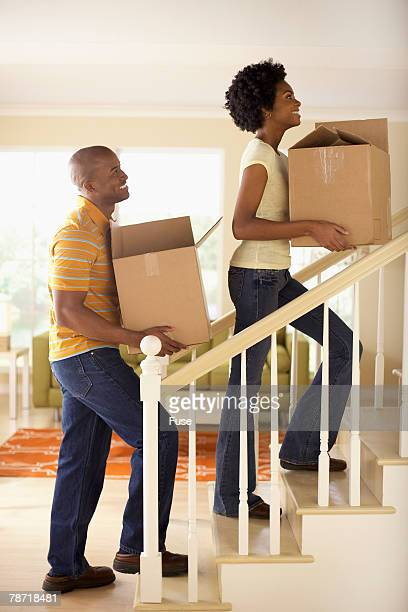 Couple Carrying Boxes up the Stairs
