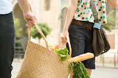 Couple carrying groceries