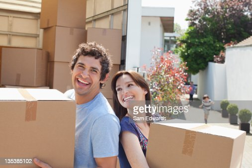 Couple carrying moving boxes : Stock Photo