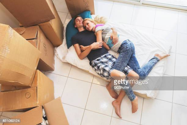Couple catching up on their sleep after an exhausting day of moving all their things to the new home