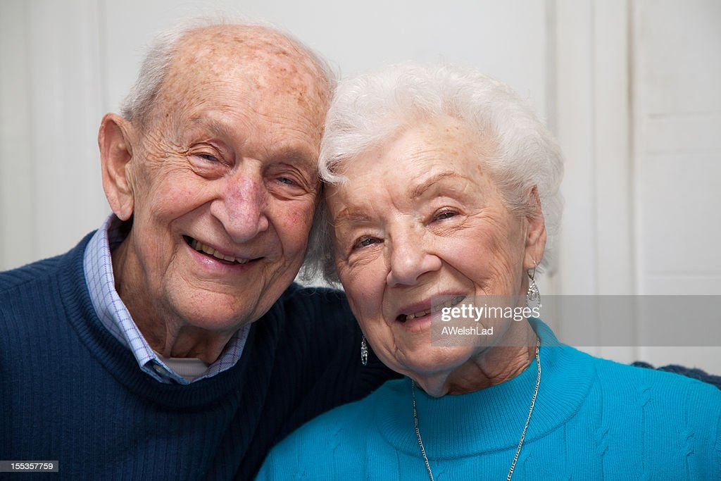 Couple celebrates 69th anniversary, leaning heads together