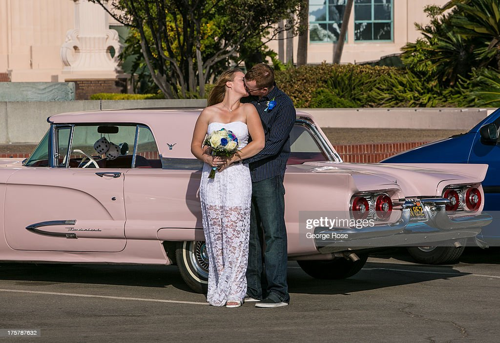 A couple celebrates their marriage at the San Diego City & County Administration building on July 31, 2013, in San Diego, California. San Diego, the eighth largest city in the United States and second largest in California, is home to the U.S. Navy and known for its extensive beaches and mild year-round climate.