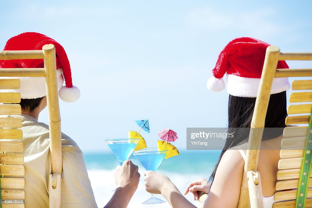 Couple Celebrating Christmas Vacation on Beach with Tropical Drinks Horizontal : Stock Photo
