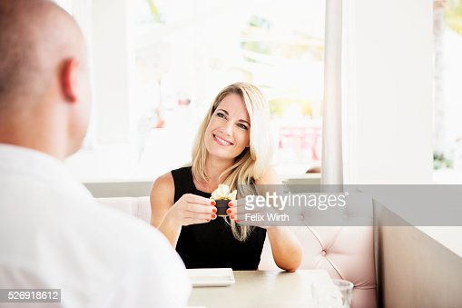 Couple celebrating engagement in restaurant : Stockfoto