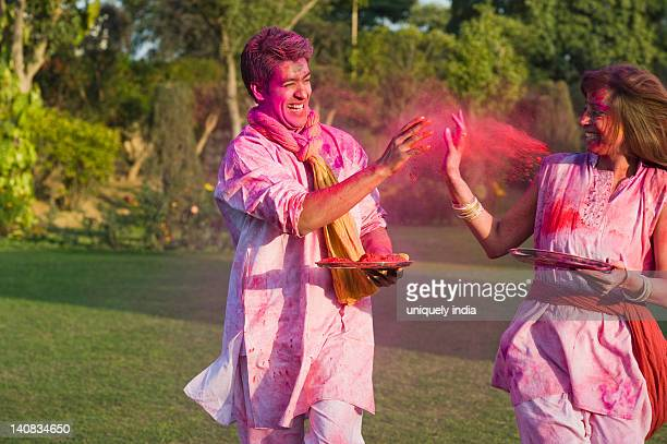 Couple celebrating Holi in a garden