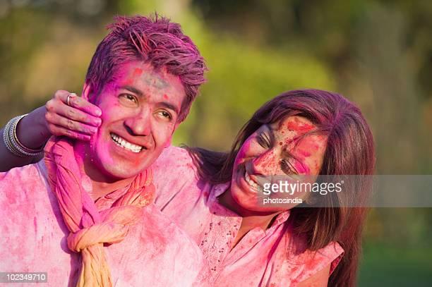 Couple celebrating Holi with colors