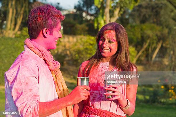 Couple celebrating Holi with glass of bhang